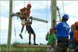 Kids climbing an obstacle course at camp