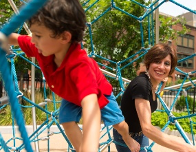 Eleni playing in the park with her son