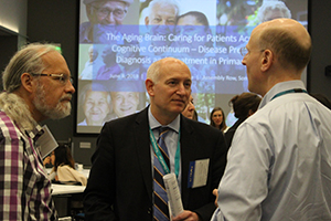 Dr. Brent Forrester talks to attendees at the Aging Brain Symposium