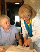 nurse helping a home care patient